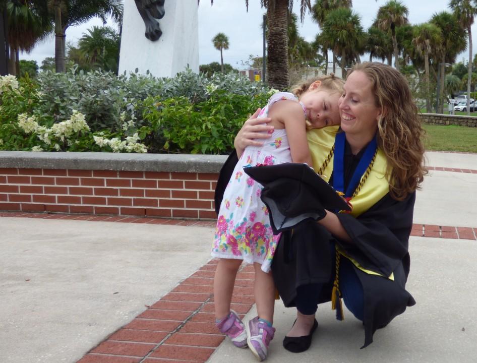 Female Florida Tech graduate posing with daughter.